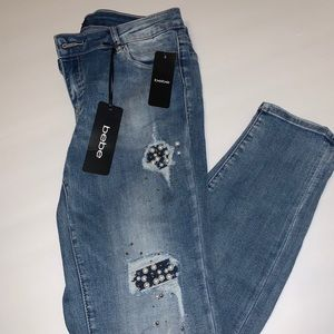 Brand new with tags BeBe jeans - size 28 *unique*